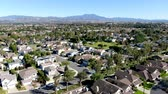 woodbridge : Aerial view of residential suburban packed homes neighborhood during blue sky day in Irvine, Orange County, USA Stock Footage