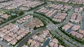 normen : Aerial view of urban sprawl. Suburban packed homes neighborhood with road. Vast subdivision in Irvine, California, USA