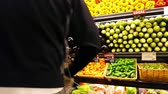 Man Picking Fresh vegetables and fruits at a farmers market 4K Stock Footage