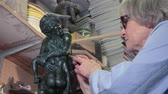 de faia : On His statue sculptor working
