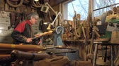 furniture : wood turner cutting shapes in wood