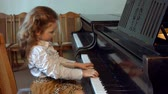 little : Cute little girl plaing grand piano 4k Hosanna of Andrew LloydWebber from rockopera Jesus Christ Superstar