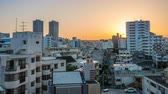 okinawa : Tilt up timelapse cityscape shot of Kokusai dori area in Naha. Shot in the morning from dark sky before sunrise until fully blue sky. Okinawa, Japan, April 2018.