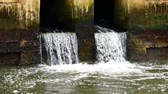 overflow pond : Daily life video After the rain. Water from a canal in the city is dropping down to the sea. To drain water and to prevent flooding in the city in flooding concept Stock Footage