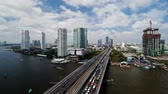 thajsko : bangkok and the chao phraya river crossed by modern motorway system in time