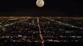 super moon : moon rising over la timelapse Stock Footage