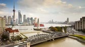 modern commerce : new pudong skyline waibaidu garden bridge looking across the huangpu Stock Footage