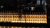 night time : parliament and big ben tilt up and zoom out Stock Footage