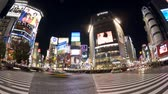 поднятый : pedestrians and traffic across shibuya crossing at night shibuya tokyo Стоковые видеозаписи