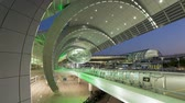 istek : People arriving and departing from Dubai International Airport with a futuristic Stok Video