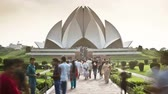 architectural : people walking along a causeway in front of the lotus temple bahai temple