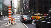 chrysler building : taxis and street scene at intersection near grand central station manhattan
