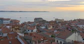 Sunset time at Piran in southwestern Slovenia on the Gulf of Piran on the Adriatic Sea.. Piran is the administrative centre of the local area and one of Slovenias major tourist attractions.