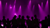 colorful : Disco Stage Dancers on the Dance Floor Colorful Vivid Lights Flashing Stock Footage