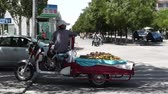 corner : Jiayuguan City street in Gansu province northwestern China - fruit vendor
