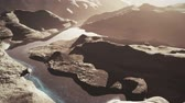 hiba : Aerial Shot of a Rocky Canyon and a Lake 3D Animation 9 stylized Stock mozgókép