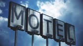 esfarrapado : 4K Old Grungy Motel Sign under Daytime Cloudy Sky Timelapse Real Clouds Timelapse and 3D Design Composite