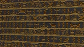 stone wall : 4K Vertical Golden Egyptian Hieroglyphs Ancient Wall v2 2 Stockvideo