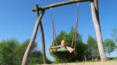 playground : Happy young girl on a swing