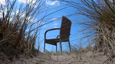 chair on a sand dune Stok Video