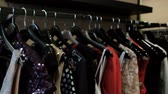 guarda roupa : Original things for women hang on a hanger in a fashionable boutique. The dress shows the key as a print. A number of new clothes collection is ready for sale in the new season after the show on the podium. Blazing blouses with paillettes are a trend in t