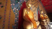 thai : Golden Buddha statues in a shrine at Wat Arun, Bangkok, Thailand