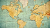 angustiado : Zoom in from World Map to North America. Old well used world map with crumpled paper and distressed folds. Vintage sepia colors. Blank version