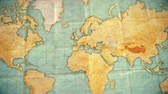 dobras : Zoom in from World Map to Europe. Old well used world map with crumpled paper and distressed folds. Vintage sepia colors. Blank version Stock Footage