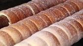 indulgence : Close up sweet Trdelnik baking on grill and rolling, this spit cake is popular in Europe, Austria, Hungary, Slovakia and Czech, especially in Prague