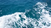 Close up background of vivid indigo blue sea water waves running aboard, alongside boat during sailing, personal perspective of action camera