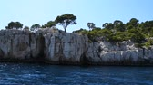 Rocky coast panning view at sea boat trip at Calanques National Park between Cassis and Marseille, South of France, personal perspective of action camera