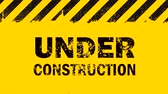 Yellow background with painted black grunge stripes and under construction sign blinking animation