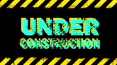 エラー : Yellow grunge painted stripes and under construction sign blinking animation with glitch over black background