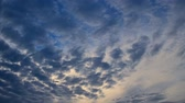 céu azul : Cinemagraph of dramatic cloudscape, dark blue clouds running in sunrise sky Vídeos