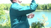 Frustrated businessman throws phone in lake after not receiving cell reception in rural Minnesota area. Vídeos