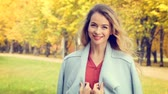 Smiling Fashion Woman on Autumn Background Stock Footage