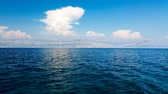 cloud : Beautiful Blue Sea and White Clouds. Adriatic Sea, Dalmatia, Croatia, Europe. Mountains in Haze on the Horizon. Summer Mediterranean Seascape.