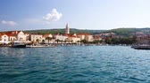 Supetar, Brac Island. Medieval Mediterranean Town in Croatia, Europe. Beautiful Blue Sea and Clear Azure Water. Popular European Touristic Destination of Dalmatia Region at Adriatic Sea. Stock Footage