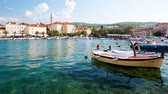 Supetar, Brac Island. Medieval Mediterranean Old Town in Croatia, Balkan, Europe. Beautiful Blue Sea, Clear Azure Water and Boats. European Touristic Destination of Dalmatia Region at Adriatic Sea. Stock Footage