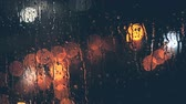 hloubka : Rain Drops Blown Away by Wind on Window. Night City Lights Bokeh Background. Rainy and Windy Weather in Autumn or Winter. Moving Raindrops. Shallow Depth of Field.
