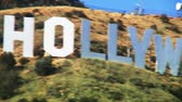 кинозвезды : Close up pan from left to right across the letters of the Hollywood sign in Los Angeles.   Стоковые видеозаписи