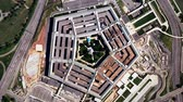terörizm : A slow aerial zoom in on the United States Pentagon building in Arlington, Virginia, shot from a satellite perspective above. Realistic animation with moving cloud shadows and traffic on the streets and freeways.
