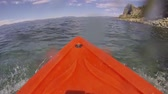 kürek çekme : A kayak point of view (POV) rowing on the Nevada side of Lake Tahoe as water splashes on and drips down the lens. Stok Video