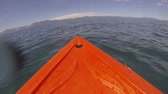 kürek çekme : A kayak point of view (POV) rowing through the open water on the Nevada side of Lake Tahoe. Stok Video