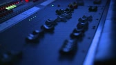 dengeleme : Floating close up on the fader controls of a professional sound mixing board.