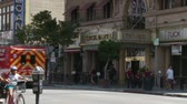 kurban : Cecil Hotel Ambulance. A Los Angeles Fire Department LAFD ambulance passes by the Cecil Hotel. Built in the 1920s, the Cecil Hotel in Downtown Los Angeles has become known for criminal activity including serveral murders, suicides, and mysterious deaths s Stok Video