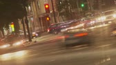 Hollywood Traffic Time-lapse. The nightlife and party-goers streak by in this soft focus time-lapse dutch angle looking South on Vine Street towards Hollywood Boulevard in Los Angeles, California.