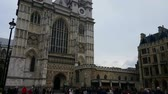 Westminster Abbey Towers. Camera tilts down from the towers of the Westminster Abbey to reveal tourists in the area.