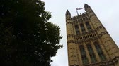 Palace of Westminster Tower. Looking up at one of the towers of the historic Palace of Westminster, built in the gothic revival style of architecture. Stock Footage