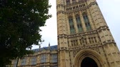 Palace of Westminster Tower, Tilt. Titling up and down to one of the towers of the historic Palace of Westminster, built in the gothic revival style of architecture. Stock Footage